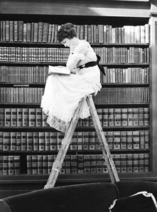 Womanreadingonladder